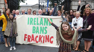 Siun Keegan-Murphy aged 7 from Leitrim with supporters outside Leinster House in Dublin in June 2017, along with Sligo/Leitrim TD, Tony McLoughlin. The group, Love Leitrim welcomed the passing of the legislative ban on fracking. Photo: Leah Farrell
