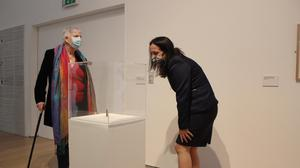Minister Catherine Martin taking a look at an exhibit during her visit to The Model, Sligo.