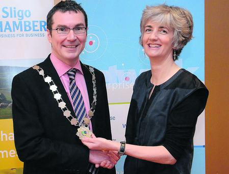 Trevor McDaid receives the chain of office as President of Sligo Chamber of Commerce from outgoing President Linda Moffitt.