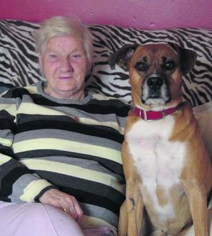 Tessie Pugh pictured with her beloved dog Rover which has been killed.