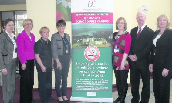 Patricia Lee, Services Manager, Grainne Mc Cann, General Manager SRH, Ann Mc Gowan, Cardiac Rehabilitation CNS, Pauline Kent, Smoking Cessation Co-ordinator, Dr Katherine Finan, Consultant Physician in Respiratory Medicine, John Mc Elhinney, Clinical Risk Advisor, Patricia Dolan, Administration Manager and some members of the SRH Smoke Free Campus working group at a Display stand for the implementation of a Smoke Free campus in the foyer of SRH.