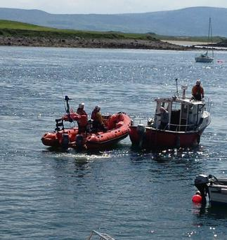 The all female crew of the RNLI Sligo bay lifeboat safely tows a boat back to the pier at Rosses Point after the owner reported engine failure on Sunday afternoon last.