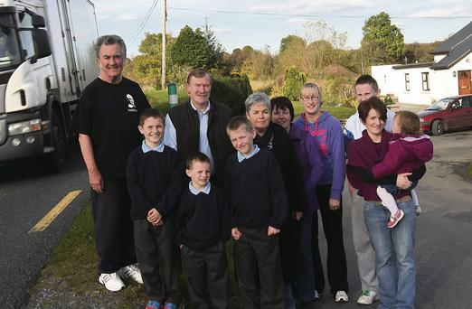 Residents pictured with Clr Jerry Lundy at the dangerous junction at Cashel Gates on the N17 last year. County Councillors have been told the possibility of getting funding for design works is 'low'.