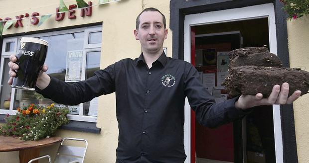 Patrick Ward proprietor of the Fox's Den, Keash, who is offering 'A pint for a bag of turf'.