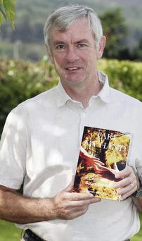 Martin McCabe with a copy of his book of short stories, entitled 'Take my Hand'