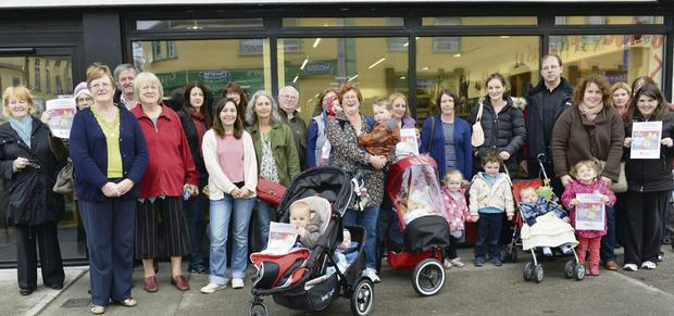 The parent and toddler group with local supporters at the library in Ballymote; inset below: Michael Ryan and Eabha Cryan keeping their house in order at the Ballymote Resource Centre.