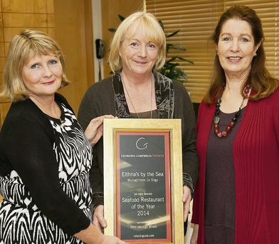 Geraldine Lane of BIM (left) and Georgina Campbell (right) present Eithna O'Sullivan of Eithna's By The Sea, Mullaghmore, with the Seafood Restaurant of the Year Award sponsored by BIM at the Georgina Campbell Awards in Bord Bia, Dublin.