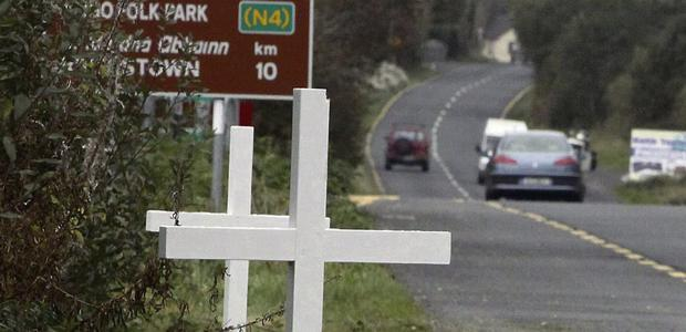 White crosses on the road close to Castlebaldwin, commemorating the people who have been killed in accidents along the N4 to Doorla in recent years.