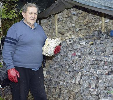 Frank Horan drying newly made briquettes at his home in Keneghan, Ballymote.