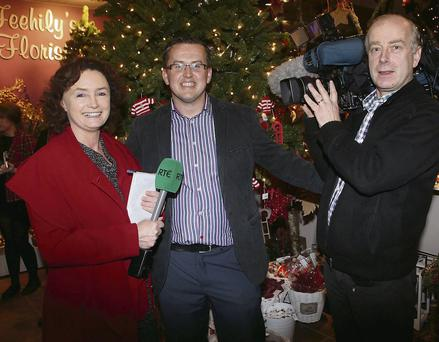 Eileen Magnier from RTÉ, proprietor Micheal Feehily, and cameraman John McMorrow during the filming for Nationwide.