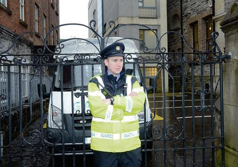 Garda Paul McDonnell on duty outside Sligo City Hotel on Thursday morning where a young guest was fatally inured in an accidental fall in the early hours.