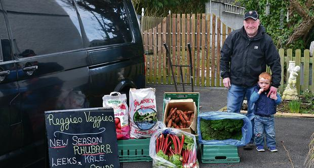 Reggie McNulty and his grandson Daithi Gethins with his Veggie produce, ready for the road.
