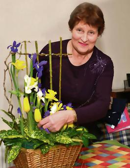Brenda Duffy designing a flower arrangement at her home in Ballymote.