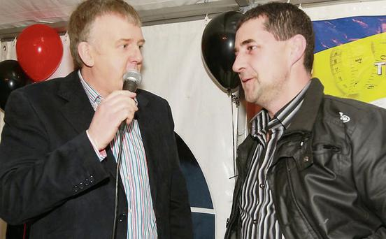 Gerry Farrell (right), first place in the men's weight loss section with compere Sean Herron.