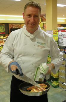 Head Chef Dave Mitchell, All Seasons Catering, about to plate up some fish at the cookery demonstration in SuperValu.