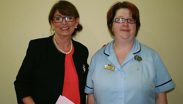 Pauline Kent, Operation Transformation organiser presenting first prize to staff nurse, Mairead Grimes.