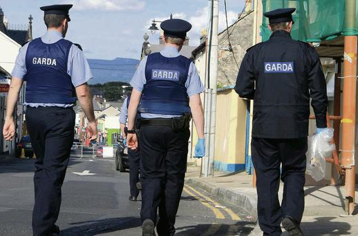 Gardai outside the home of victim Eugene Gillespie in September 2012.