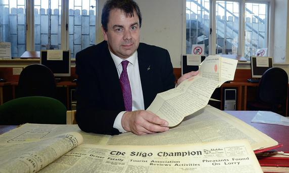 Hugh Trayer researching the First World War through The Sligo Champion. He is also pictured with the last will and testament of Captain Thomas Joseph Crofton from Ballisodare, who fought in the War.