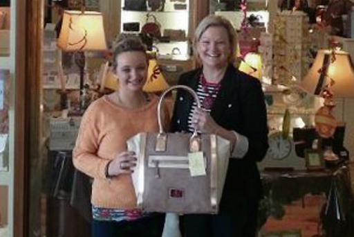 Aisling O'Hara, Allure, and Mary McKeown, North West Simon Community, launching the draw for a designer handbag for those who donate bags to the 'Handbags' appeal.