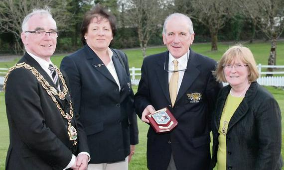 The Lord Mayor of Birmingham, Councillor Mike Leddy, making a presentation to Tubbercurry Golf Club in recognition of the fundraising efforts of members to purchase a bus for the Irish in Birmingham. Included are Lady Captain, Mary Conway, Captain, Joe Kilcoyne, and Lady Mayoress, Pauline Leddy.
