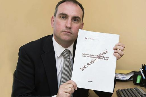Senator Marc MacSharry with the confidential report.