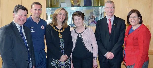 Helen Browne, centre, who retired last week from Sligo Borough Council after 42 years, pictured with Clr David Cawley, Sligo Rovers manager Ian Baraclough, Mayor Marcella McGarry, Clr Declan Bree and Clr Veronica Cawley.