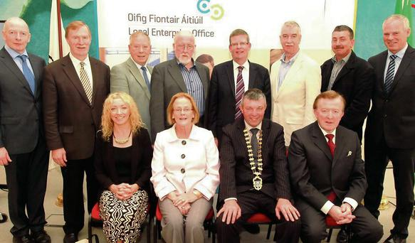 Chairman of Sligo County Council Joe Queenan pictured with chief executive Ciaran Hayes and councillors and officials at the launch of the new Enterprise office at City Hall.