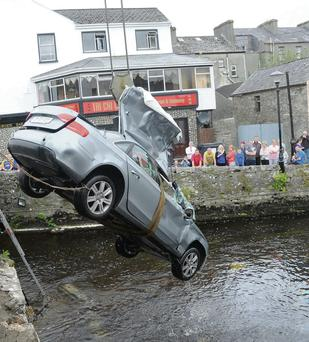 The car being removed by crane from the Boyle River. Pic: Mary Regan.