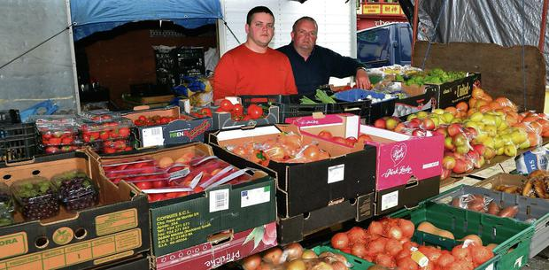 Colin and Philip Gorman at their fruit and vegetable covered stall at The Square, Tubbercurry last Thursday. Photo: Tom Callanan