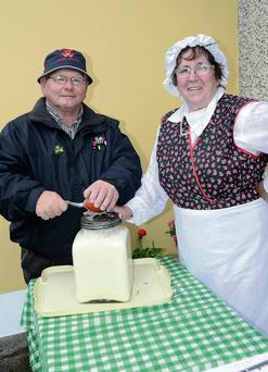 Austin Coleman from Carnaree and Angela McLoughlin from Ballintogher making some country butter