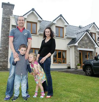 Phillip, Lorna, Noah and Grace Newell outside their new home at Oyster Bay, Rosses Point, Sligo