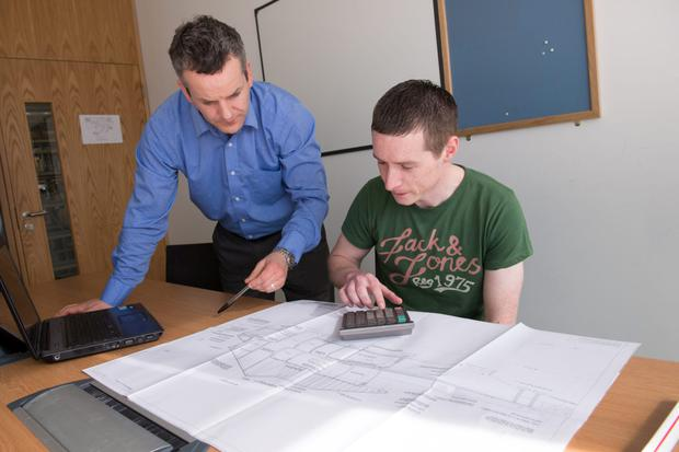 Leigh McLoughlin, Lecture in Quantity Surveying at IT Sligo assists a student