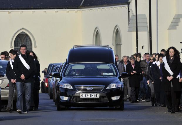 The funeral cortege of Natalie McGuinness leaving St James' Church Easkey for Churchill Cemetery, Dromore West where she is buried