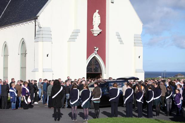 Mourners outside the church at the funeral of childcare worker Natalie McGuinness, 23, on Saturday in her home village of Easkey
