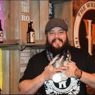 Brewmaster Joe Kearns displaying the medals won by The White Hag Brewery