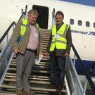 David McGowan (right) on the steps of the jumbo he's floating to Enniscrone beach this week