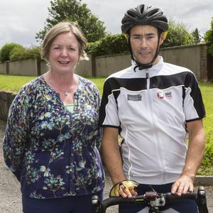 Mary Tighe with charity cyclist Aidan Hegarty