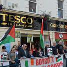 Protesters outside Tesco against the sale of Israeli products
