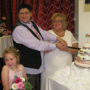 Icing on the cake: Casi and Dee cutting their wedding cake, pictured with Dee's grandniece Briana Greene