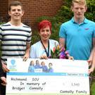 Sons of the late Bridget Connolly from Tubbercurry - Brendan, Niall, Stephen and Paul with staff nurse Siobhan Tierney Pike of Richmond Intensive Care Unit in the Beaumont Hospital, Dublin with a cheque in memory of their mother. The money was raised through a football match played between a past and present St Attracta's teams