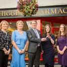 Ken Higgins handing over the keys to the new pharmacy owners, Ann and Deirdre Butler. Also pictured is Ann Christine and Stella Higgins