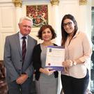 Claire Hegarty receives her certificate from Jerry Bohan and Ana Izquierdo at Dublin Castle