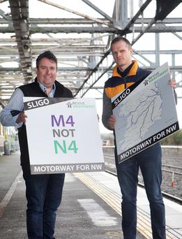 Campaigners Anthony Gray and Brendan Tierney get ready for Wednesday's march to Dublin