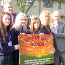 Michael McHugh (Chairman Sligo IKA) pins the Forget-me-not flower on Mayor of Sligo Marie Casserly at the launch of Organ Donor Awareness Week at the Garden of Reflection, Doorly Park. Also included Ursuline College TY students with their teacher, Jane Carty and committee members from Sligo IKA branch