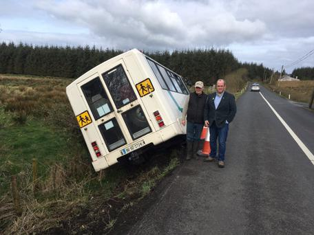 Councillor Chris MacManus and Sooey resident Pat Davey at the scene of the minibus crash near Gleann. Pics: Donal Hackett and Cllr MacManus