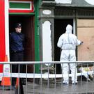 Gardaí carrying out an forensic examination of the fatal fire on Saturday morning