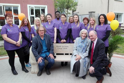 Resource House staff pictured with Michael, Mary and Tommie Gorman at the unveiling of the bench in memory of their sister, Paula Gorman