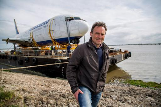 David McGowan pictured beside the Boeing 767 which he managed to get to Enniscrone from Shannon by road and sea for his Quirky Nights Glamping village which he hopes to open next summer provided he can get funding in place