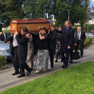 The coffin of former Editor of The Sligo Champion Seamus Finn being carried into St Joseph's Church by his eldest son Seamus (left), his sister Breege (centre) and his son Kevin (right)