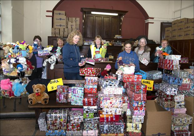 Filling the Christmas shoeboxes at Ballymote: Vivienne Draper, Anne Feehily, Jennifer Irwin, Marie Donohoe, Ann Helemstettle, Susi Grefth, Dympna O'Driscoll and Nikki Maxwell. Pic: Tom Callanan.